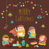 Card with cute kids, sweets and christmas presents Royalty Free Stock Image