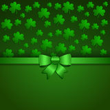 Card for day of Patrick with a clover and a bow. On a festive background. With the place for the text Royalty Free Stock Photos