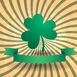 Card for day of Patrick with a clover. On a festive background. Stock Photos