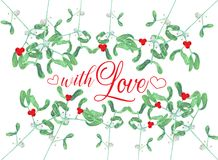 Card decoraetd with mistletoe and red berries Stock Photo