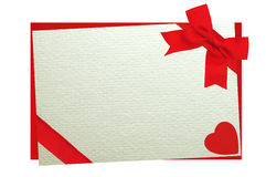 The card decorated with a red bow on envelope isolated on white Royalty Free Stock Images
