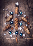 Card with decoration  christmas tree: fir cone, balls, snowflake Royalty Free Stock Images