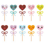 Card design with hearts Kawaii Colorful Sweet Cake pops with pink cheeks and winking eyes, Cake pops hearts set with bow isolated Royalty Free Stock Photo