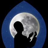 Card design of muslim pray on blue moon Stock Image