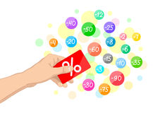 Card and discounts. Red plastic card with white percent sign in one's hand and multicolored circles with discounts around Stock Photography