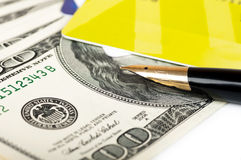 Card and dollar bills and a fountain pen close Royalty Free Stock Image
