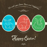 Card for Easter day with colored  eggs painted with  rabbits. Royalty Free Stock Image