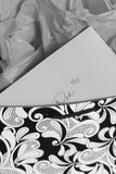 Gift for Dad. A card and envelope made out to Dad set in a paisley textured black and white bag and gray grey tissue paper Stock Photography