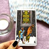 Five V of Pentacles Tarot Card Hard Times Poor Health. This card is about Financial burdens, Recession, Cursed, Bad Luck, Ruin, Bankruptcy and Debts stock photos