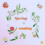 Card with floral wreath and flowers with spring is coming in the center Stock Photos