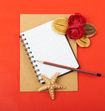 Card with flowers. Shells and pencils on red background Royalty Free Stock Photography