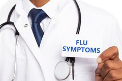 Card with flu symptoms held by medic. White card close-up with fly symptoms text written on it held by indian medic man royalty free stock photo