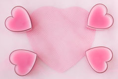 Card with four pink hearts, paper and greed Royalty Free Stock Photo