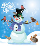 Card with funny snowman and birds on blue snow background. Cartoons for winter, Christmas or New Year design. Hand written text Merry Christmas Royalty Free Stock Images