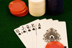 Card game. Close up of cards and chips on green felt with winning hand Stock Photography