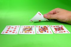 Card game. Turning a card to find a royal stright flush Royalty Free Stock Image