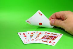 Card game. Turning a card to find a royal straight flush Royalty Free Stock Photos