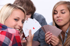 Card game. Teenage friend playing a card game Royalty Free Stock Photography