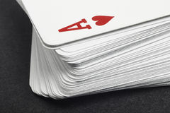 Card game with ace of heart detail. Black background Royalty Free Stock Image