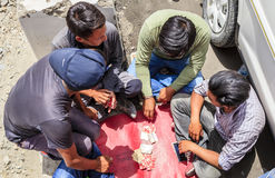 Card game. Ladakh, India - July 10, 2016: Taxi drivers play cards wile waiting for their passengers Royalty Free Stock Photography