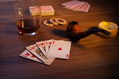 Card game in the late evening, with candles. stock photography