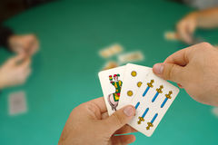 Card game with Neapolitan cards. Card game with Neapolitan cards typical of Naples Stock Images