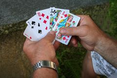 Playing cards in hands Royalty Free Stock Photos