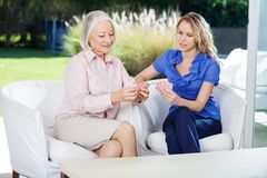 Card game with Senior and Mid adult woman. Royalty Free Stock Images