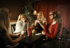 Card Game at Table with Same Woman Royalty Free Stock Image