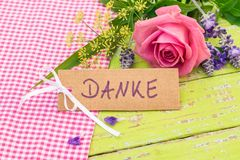 Card with german word, Danke means thank you and romantic pink rose flower. Bouquet of flowers with romantic pink rose and card with german word, Danke means Royalty Free Stock Images
