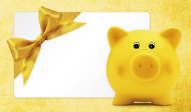 Card gift with piggy bank, golden ribbon bow, Isolated on yellow Royalty Free Stock Photography