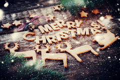 Card with Gingerbread Cookies. Letters Merry Christmas and Figures Royalty Free Stock Image