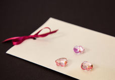 Card and glass hearts Royalty Free Stock Photography