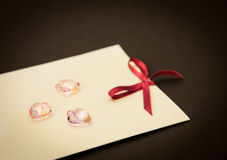 Card and glass hearts Royalty Free Stock Images