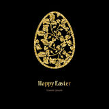 Card with golden openwork Easter egg with leaves and space for text. Royalty Free Stock Photography