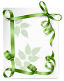 Card with green gift bows with green ribbons Stock Photos