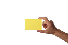 Card in the hand. Yellow card in the hand, isolated on white background Stock Photography