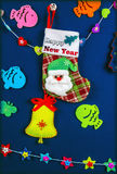 Card. Handmade card `Happy New Year`. New Year`s stocking with funny Santa Claus Royalty Free Stock Photography
