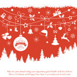 Card with hanging Christmas ornaments over fir tree landscape Stock Image