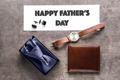 Card with HAPPY FATHER`S DAY inscription and gifts. On table Stock Photo