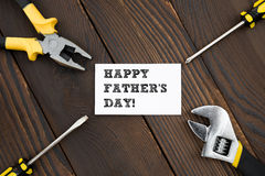 Card of HAPPY FATHER'S DAY and tools. On wood Stock Photo