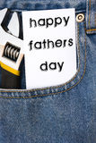 Card of HAPPY FATHER'S DAY. And wrench on blue jean Stock Photography