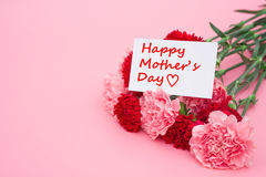 Card of happy mother's day and prensent box and red carnations Royalty Free Stock Image