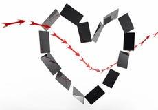 Card heart and arrow Stock Photo