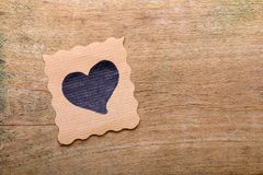 Card with heart drawing on wooden background. Copy space. Valentine`s day background royalty free stock photo