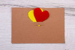Card and hearts. Greeting card on wooden plank. Simple handmade for holiday. Write all your wishes Royalty Free Stock Photography