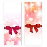 Card with hearts and ribbon with a bow. The concept of Valentine's Day Stock Photo