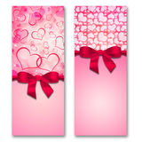 Card with hearts and ribbon with a bow Stock Photos