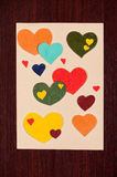 Card with hearts on wooden Royalty Free Stock Photography