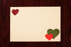 Card with hearts on wooden background Royalty Free Stock Images